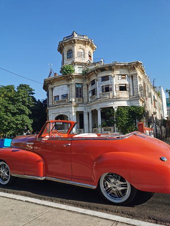 La Habana... On the picture is old chewrolet from 1957 and the oldest haus in New Habana...