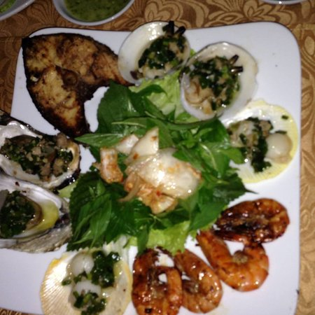 sliced fish and oysters