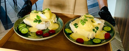 try our one of the best breakfast of Here & There Cafe.  Egg Benedict with the twist by Here & There. Come and Visit to experience...