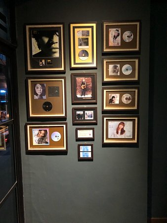 Wall of Fame with collaborated artists at the café.