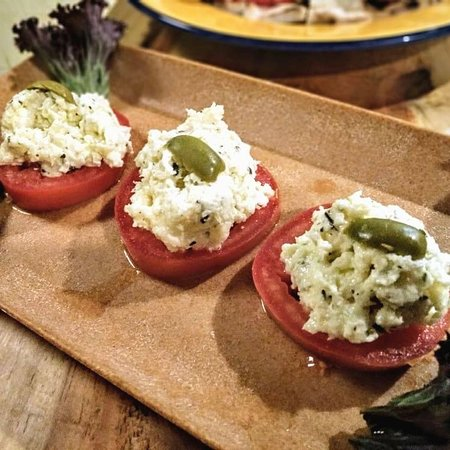 Fresh tomato and spiced ricotta tapa.