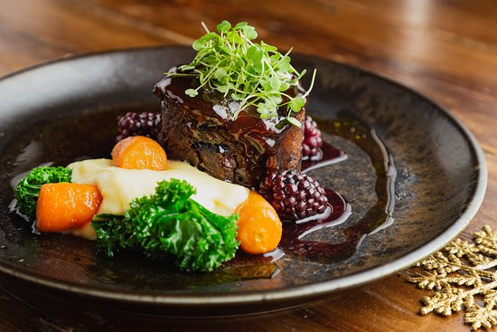 Braised beef blade, Maple and cranberry glaze, buttered mash potato, roasted carrots, clove infused blackberries, red wine jus