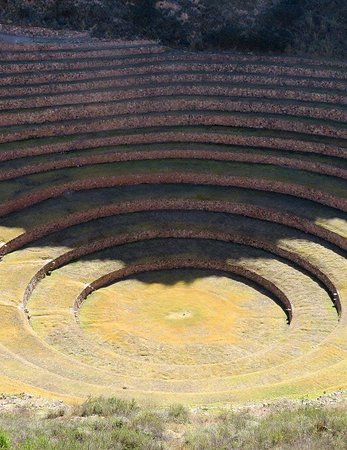 Maras, Peru: SEVERAL PERFECT CIRCLES IN THE RUINS OF MORAY. Built-in the natural holes of Misminay Cusco Peru. The ancestral men of the Andes played genetically with the plants in this natural laboratory. On the winter solstice, on June 24, they performed ceremonies dedicated to the plants and energies of Mother Nature.