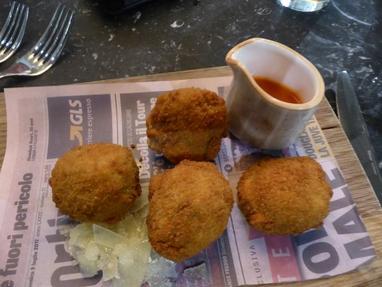 Arancine Crispy mushroom Risotto Balls mozzarella tomato and red pepper sauce