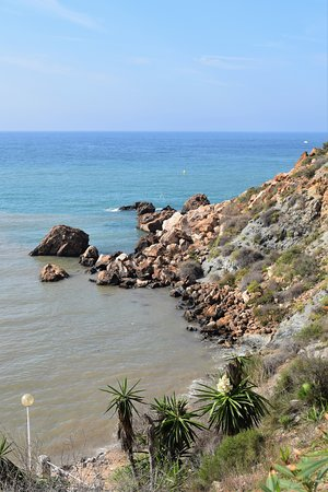 The rocky bits at the edge are good for snorkelling at Cala Cortina