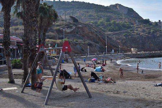 Playground equipment for children on the beach at Cala Cortina