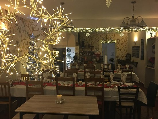 Christmas at the Courtyard with the tables laid for the Christmas parties, plus the seasonal Christmas wrap, roast turkey, stuffing, pigs in blankets, roast potatoes and seasonal vegetables, served daily on the specials