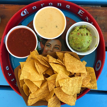 Tres Grande! Guacamole made fresh daily, salsa, and warm queso with house made tortilla chips