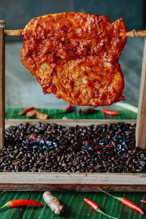 Chicken on Fire (Southern Region): Char-grilled chicken marinated with Southern spices and coconut