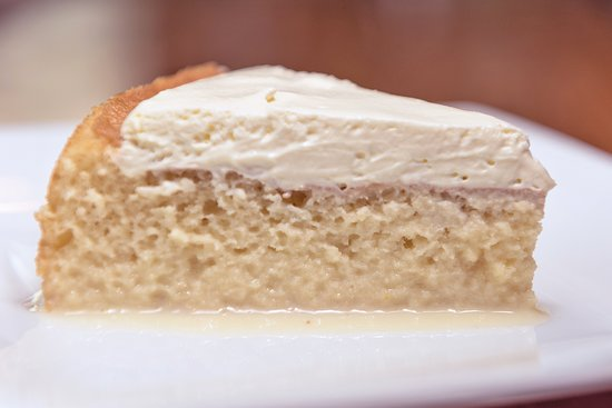 Tres Leches ~ Light and airy sponge cake soaked in 3 different types of milk which is  topped with the right amount of unsweetened whipped cream to give you the perfect balance of sweetness