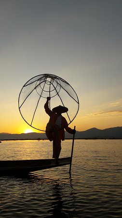 The fisherman is trying to catch the fish in Inle Lake,Myanmar.
