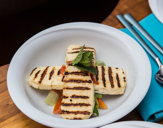 HELLIM Charcoal grilled traditional Cypriot Halloumi cheese, served on a bed of salad