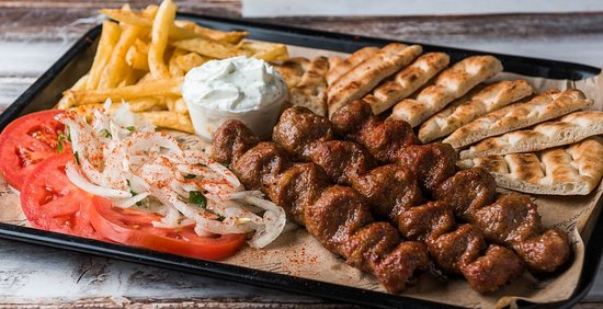 Main Dish: Kebab (60% beef, 40% lamb) - 3 skewers, tomato, onion, fries, yogurt sause, pita bread