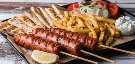 Main Dish: Traditional Sausage (3 skewers, tomato, onion, fries, tzatziki, pita bread)