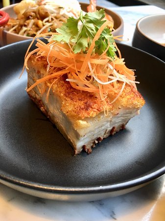 Crispy Pork Belly: Pork belly baked in the oven under a layer of Coarse Salt served with ginger and green onion sauce.