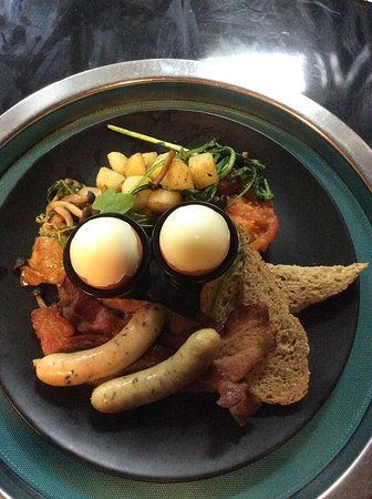 Full Brekky: Two eggs any style, bacon, Pork or Chicken Cumberland  sausage, sauteed potatoes, roasted tomato, mushroom and toast.