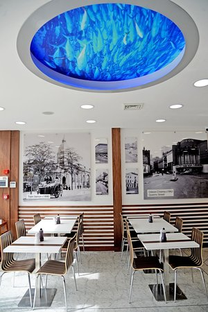 A view of some of the eating area, our famous pictures and the fish tank.