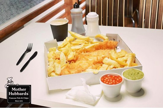 The super jumbo and chips with a side of mushy peas and baked beans.