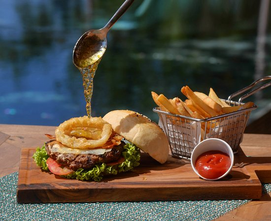 Artisan bread, 7oz. grilled beef, jalapeño jam, swiss cheese, crispy bacon, chipotle alioli, with french fries - Duna's Burger