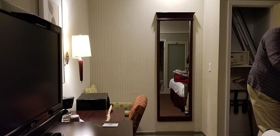 """View of """"separate seating area"""", closet and safe"""