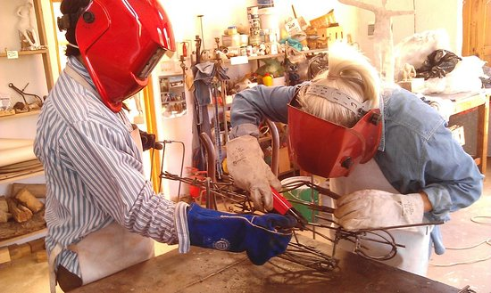 Welding,and working with the angle grinder to build up an armature, the fiirst stage in the ferrocement sculpture workshop