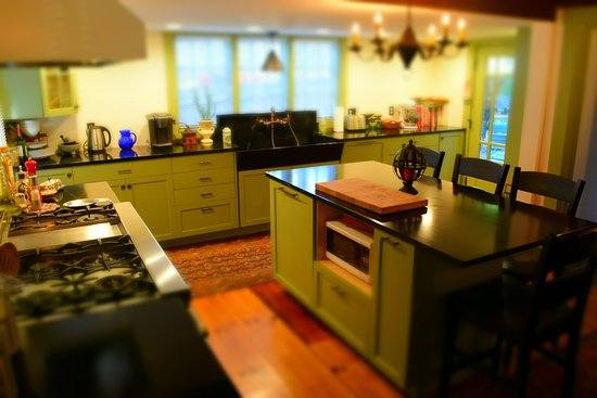 Kitchen used for food preparation during private events only. Featuring a 6 burner commercial range and original 4 ft soap stone sink.