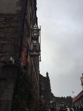 As you look uphill towards Edinburgh Castle.
