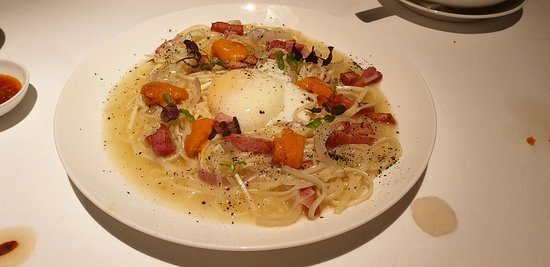 Park Carbonara Inaniwa Udon - fusion mix of ingredients to produce a creamy and tasty dish topped with sea urchin, 65 degree organic egg and pork ham