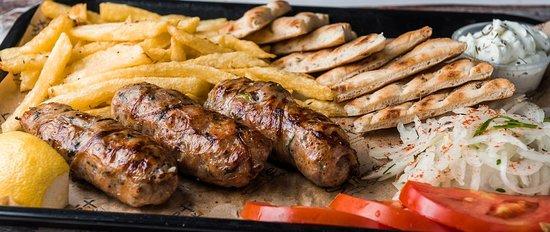 Main Dishes: Seftalia Kebab from Cyprus (3 sticks, tomato, onion, fries, yogurt sause, pita bread