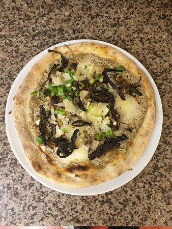 "Magic Mushroom Chanterelle mushrooms, Oyster Mushrooms, Mozzarella, Black Cabbage, Mushroom Cream, Spring onion, Gorzano Sheep""s milk cheese."
