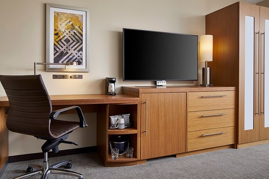 """All rooms feature a 55"""" television, power port, refrigerator and work desk."""