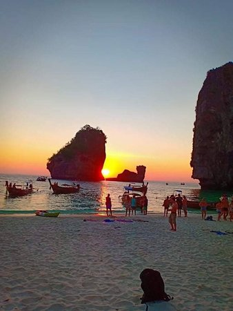 Nui Bay , phi phi island. It's at the west of the island so it's perfect for sunset. And you can book a tour here at the resort.