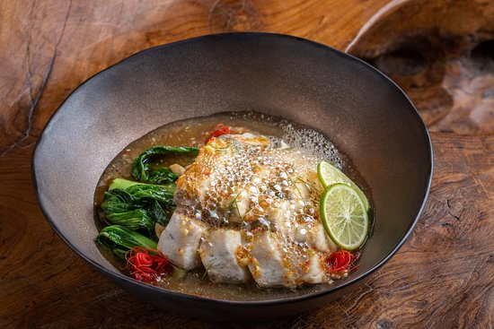 Pla Nueng Ma Nao, steam sea bass with lemongrass, galangal and spicy lime dressing.