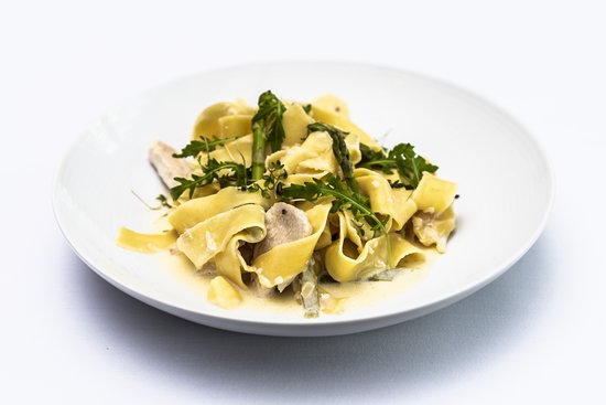 Homemade pappardelle with chicken breast and asparagus