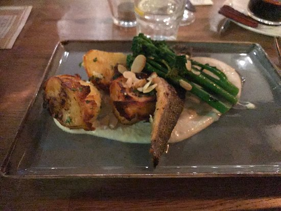 Sea bass with roast potatoes in a white sauce