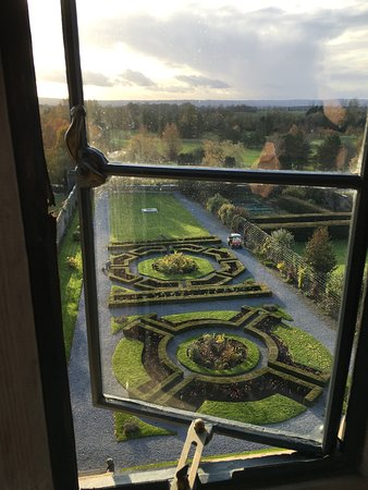 View into the distance and over the formal gardens at Kilkea Castle from the Sir Thomas de Rokeby room.