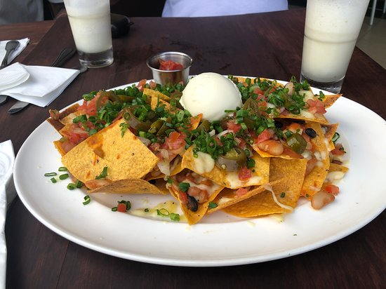 Great atmosphere and service as usual. Live band was great... Food was good but expensive for family of 5 - as were drinks. Not many options for non meat eaters, but nachos was yummy! TIP: Visit in happy hour where you can get two for one drinks...