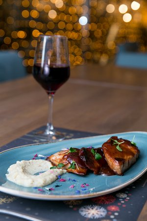 Red wine is the ultimate pairing with this glazed pork from our Christmas Menu!