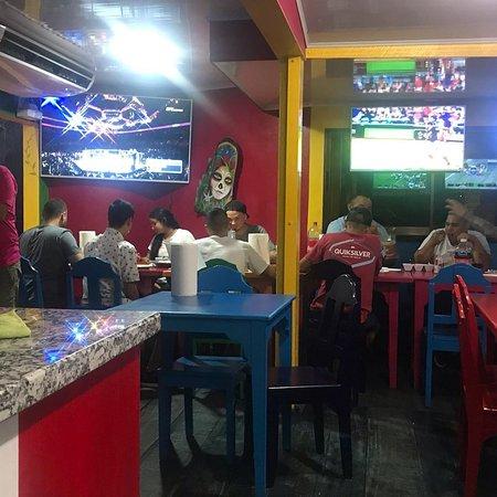El Chicano Mexican Food restaurant interior, tvs and ac.