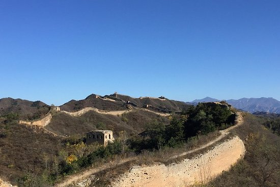 Hiking on the Great Wall ruins of...