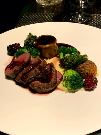 Main: Venison with black pudding, kale and blackberry.