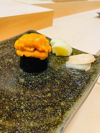 Wow, excellent edomae style sushi in Ginza! Chef Takahashi San from Ginza Onodera Sushi (ex-head chef at Ginza Onodera Sushi) Now, he took over his father's sushi place and changed the restaurant name to Gintomi (Ginza + his father's name 'Tomi') Not only chef Takahashi San is so talented, he also interacts with customers very well. He does speak and understand English. Highly recommended! It might be easy to make reservations now, but not for too long.  9 seats L shape sushi counter.