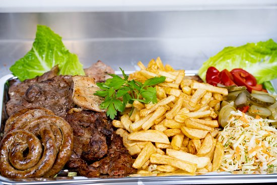 Romanian grill: pork, chicken, mici (grilled ground meat rolls), fries and salad.