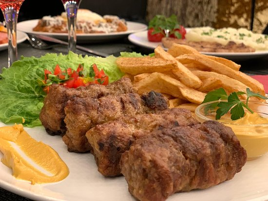 Mititei - grilled ground meat rolls with fries and homemade wine