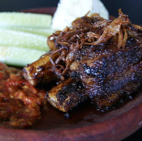 One of our signature dishes, Iga Bakar is an Indonesian stlye BBQ beef Ribs.  We highly recommend eating it with our special Terasi Sambal which compliments the Iga Bakar and gives it a little kick