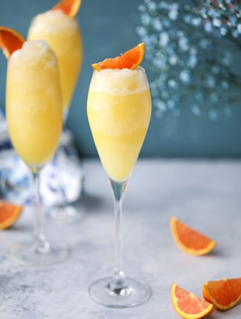 """Enjoy bottomless Mimosas and frozen """"Fromosas"""" every Saturday and Sunday at Brunch."""