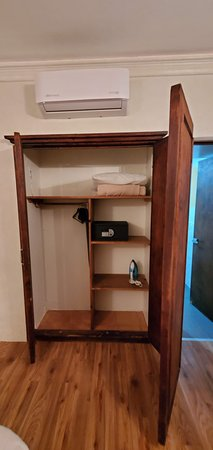 Nice wood closet complete with safe.