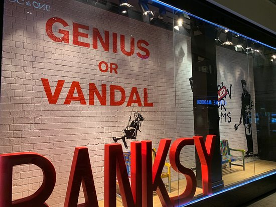 ‪Banksy Exhibition: Genius or Vandal?‬