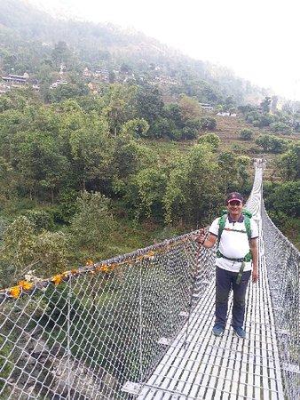 Suspension bridge on the way to Sarangkot via Naudanda from Dhampus. www.mountainkingtreks.con ( info@mountainkingtreks.com )