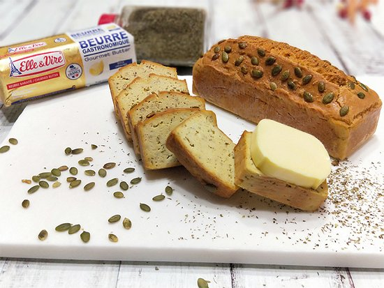 Keto, gluten-free pumpkin seed focaccia bread, made with almond flour and Elle&Vire butter. Available per slice / whole loaf.